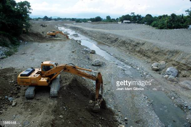 Bulldozers work to wide the Pelo River in El Progresso Honduras October 1999 In October 1998 Hurricane Mitch roared through Central America causing...
