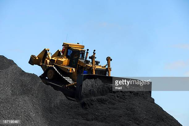 Bulldozing a mountain of coal