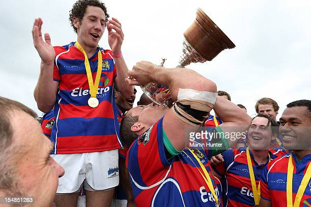Buller captain Ben Coman celebrates with the Lochore Cup after the Lochore Cup Final match between Buller and South Canterbury at Victoria Square on...