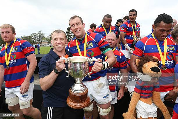Buller coach Craig Scanlon and Ben Coman celebrates with the Lochore Cup after the Lochore Cup Final match between Buller and South Canterbury at...