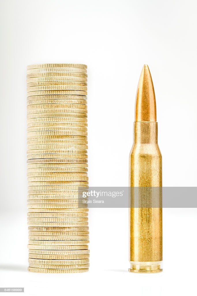 Bullet and coins : Stock Photo