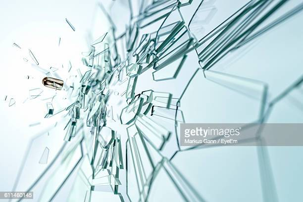 bullet breaking glass - exploding glass stock photos and pictures