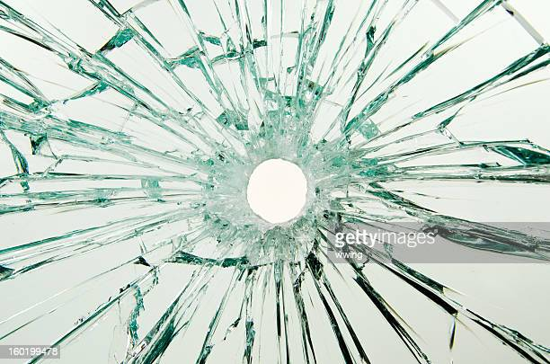 bullet hole glass - bullet hole stock pictures, royalty-free photos & images