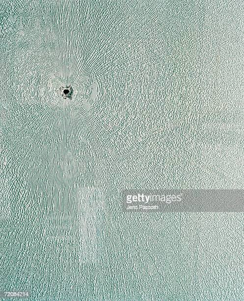 Bullet hole in textured surface