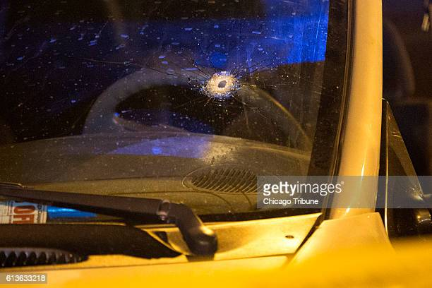 A bullet hole in the windshield of a vehicle at the scene of a shooting in the first block of North Laramie Avenue on Saturday Oct 8 in the South...
