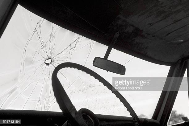 bullet hole in windshield - bullet hole stock pictures, royalty-free photos & images