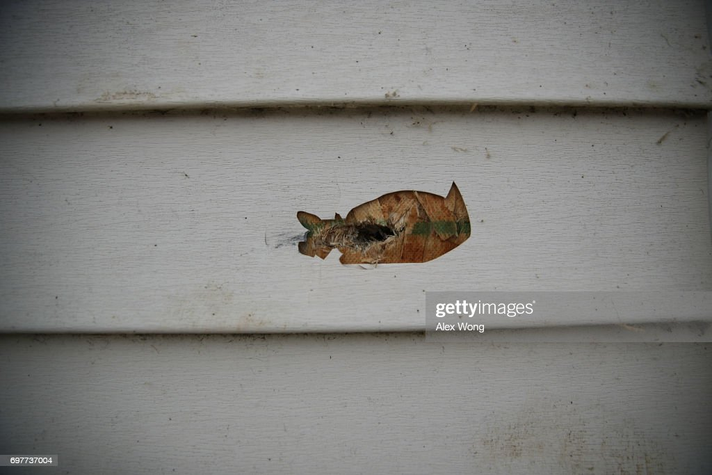 A bullet hole is seen on a shed at the Eugene Simpson Stadium Park, the site where House Majority Whip Rep. Steve Scalise was shot by gunman James Hodgkinson, June 19, 2017 in Alexandria, Virginia. Investigators have concluded their investigation at the shooting scene and the area has been reopened to the public.