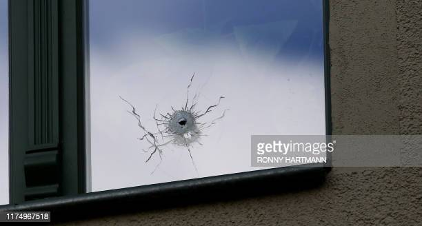 Bullet hole is seen on October 10, 2019 in a window next to the synagogue in Halle, eastern Germany, on October 10 one day after the attack where two...