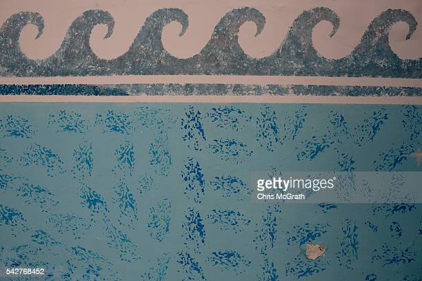 A bullet hole is seen on the wall of the indoor pool at the closed Imperial Marhaba Hotel on June 24 2016 in Sousse Tunisia The Imperial Marhaba...