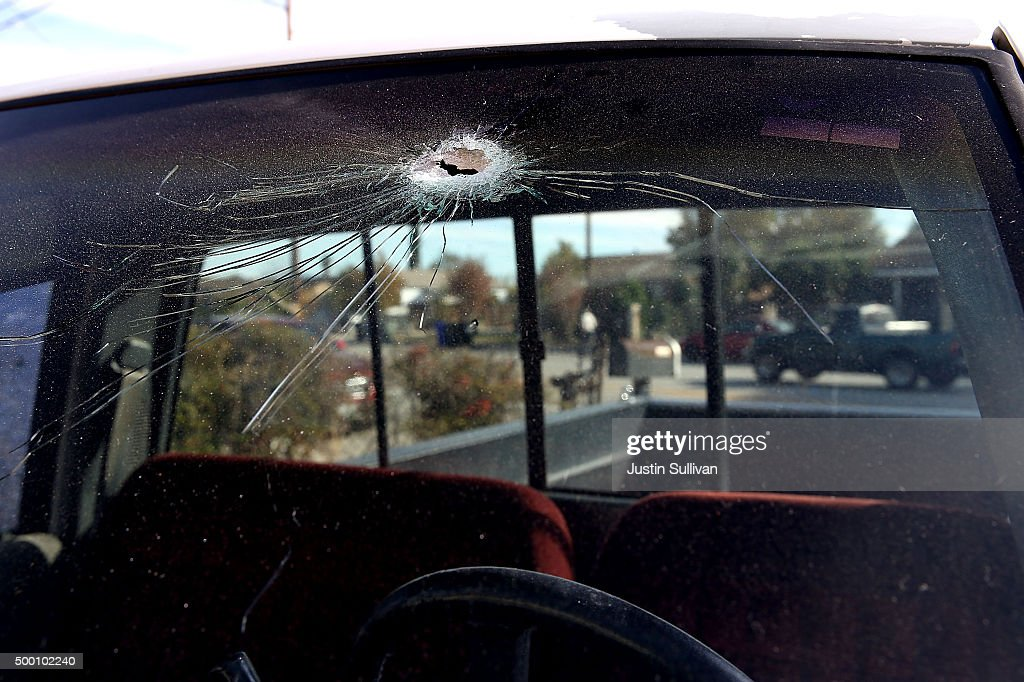A bullet hole is visible in the windshield of a truck near the scene where shooting suspect Syed Farook and his wife Tashfeen Malik were shot and killed by police following the mass shooting at the Inland Regional Center on December 5, 2015 in San Bernardino, California. The FBI has officially labeled the attack carried out by Syed Farook and his wife Tashfeen Malik as an act of terrorism. The San Bernardino community continues to mourn the attack at the Inland Regional Center in San Bernardino that left at least 14 people dead and another 21 injured.