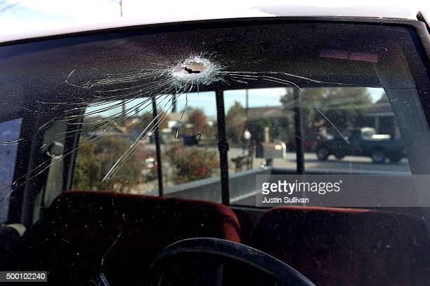 A bullet hole is visible in the windshield of a truck near the scene where shooting suspect Syed Farook and his wife Tashfeen Malik were shot and...