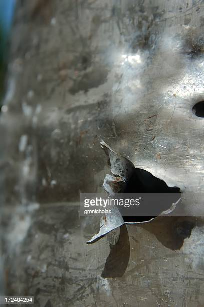 bullet hole - bullet hole stock pictures, royalty-free photos & images