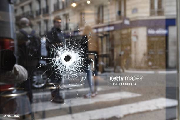 TOPSHOT A bullet hole seen on the window of a cafe located at the crossroads between the streets SaintAugustin and Monsigny is pictured on May 13...