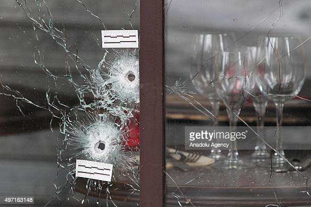 """Bullet holes are seen as the French police takes security measures at Bataclan concert hall and """"La Belle Equipe"""" restaurant in 11th district of..."""