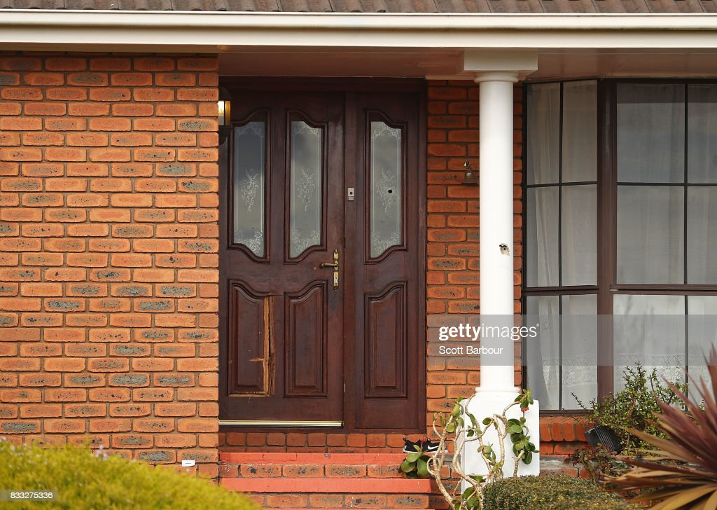 Bullet holes are seen in the front door and windows after a drive-by shooting at a property in Narre Warren in Melbourne's south eastern suburbs on August 17, 2017 in Melbourne, Australia. Homicide detectives are investigating the death of a 26-year-old man who was killed at the Kurrajong Road house as a result of the shooting.