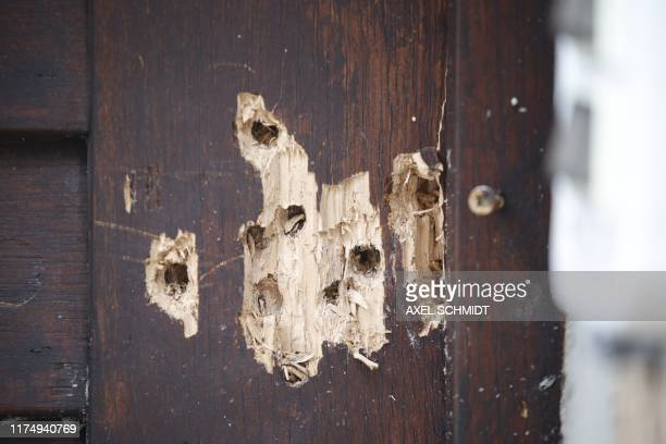 Bullet holes are seen on October 10, 2019 at a door of the synagogue in Halle, eastern Germany, one day after the attack where two people were shot...