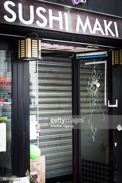 Bullet holes are seen on the window of Sushi Maki restaurant next to La Belle Equipe bar in Rue de Charonne one of the places attacked by terrorists...