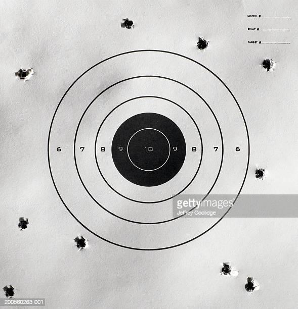 bullet holes around bull's-eye of shooting target - agujero de bala fotografías e imágenes de stock