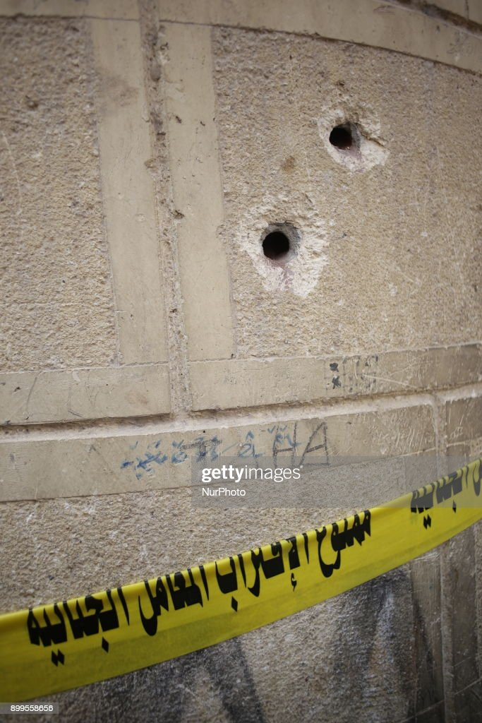 Bullet holes can be seen at the gates of Mar Mina church, following a gun attack on the church in Helwan, southeastern Cairo, Egypt, 29 December 2017. At least nine people killed among them a police officer and at least another five were injured after two assailants opened fire on the church. Police killed one attacker in an ensuing clash, and another suspect was later arrested.