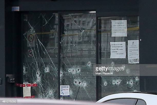 Bullet holes can be seen at the kosher market 'Hyper Cacher' which suffered a terrorist attack yesterday on January 10 2015 in Paris France Four...