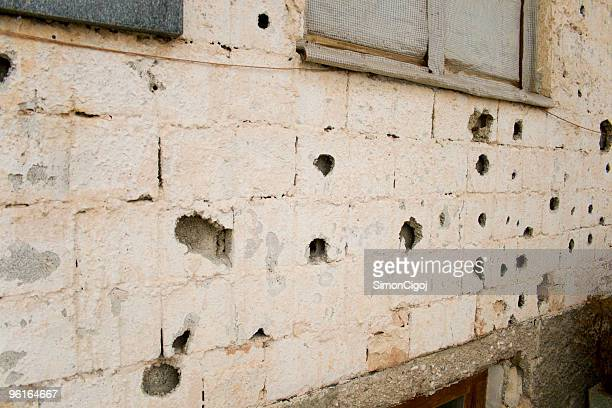 bullet holes in a house facade - guerrilla warfare stock pictures, royalty-free photos & images