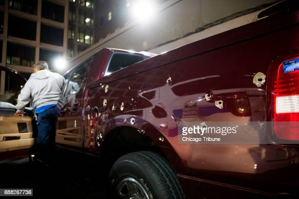Bullet holes pepper a car that was driven to Mount Sinai Hospital by a 14yearold boy and 17yearold boy who were shot near the intersection of 25th...