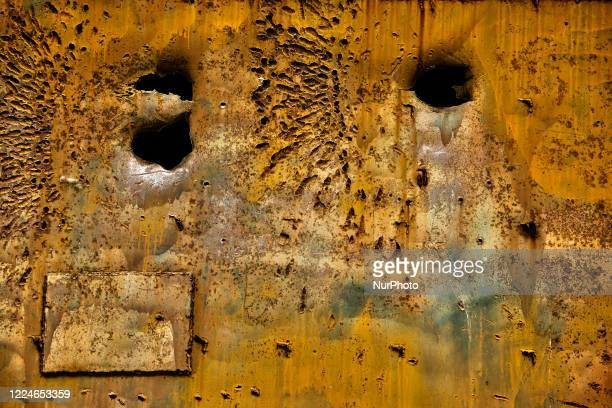 Bullet holes seen in the amour plating of the improvised armored bulldozer belonging to the Liberation Tigers of Tamil Eelam during the First Battle...