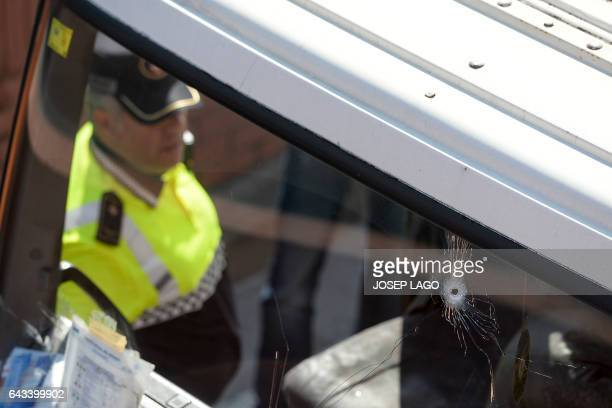 CORRECTION Bullet impacts are seen on the windscreen of a butane gas delivery truck against which police had to shoot to stop it in Barcelona on...