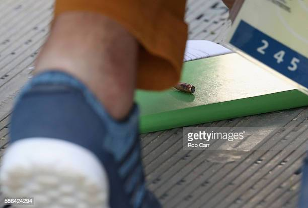 A bullet is seen inside the media centre at the Olympic Equestrian Centre after it went through the wall of the media centre during competition in...