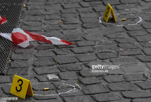 Bullet markers placed by forensic policemen at the crime scene of the Camorra ambush of the Camorra in downtown Naples, southern Italy. Three people...