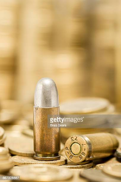 Bullet over coins