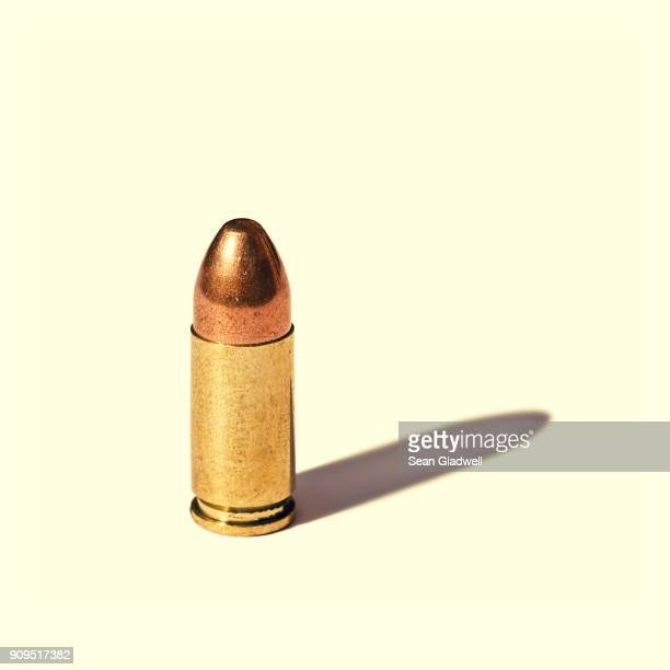 bullet - brass stock pictures, royalty-free photos & images