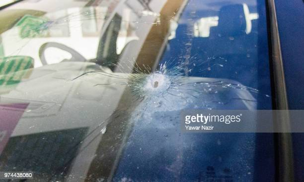 A bullet riddled car of Syed Shujaat Bukhari the editor of Rising Kashmir daily newspaper killed by unidentified gunmen outside his office on June 14...