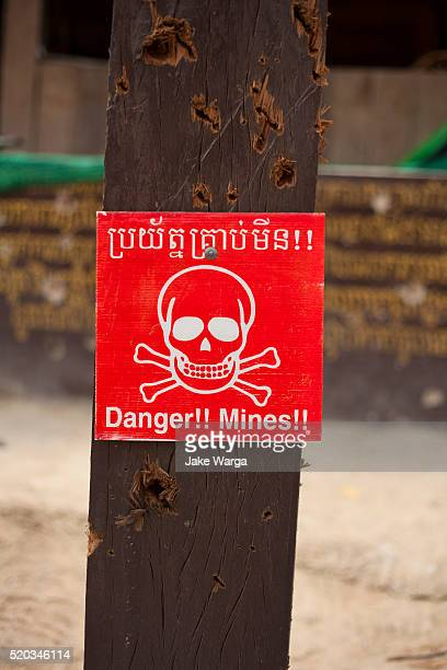 Bullet riddled Landmine Caution sign, Preah Vihear temple, Cambodia