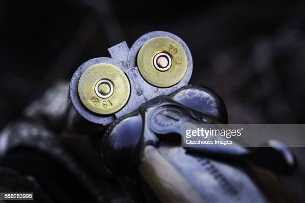 bullet shells in double barrel shotgun - shotgun stock pictures, royalty-free photos & images