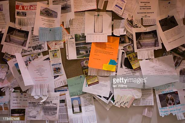 A bulletin board for community notices on July 14 2013 in LacMegantic Quebec Canada A train derailed and exploded into a massive fire that flattened...
