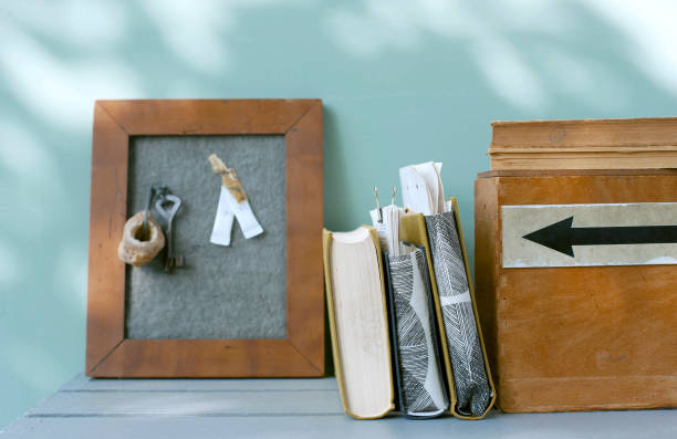 DIY bulletin board made of felt and picture frame, wooden box, book and document holders made of book covers