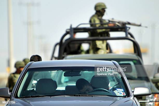 A bulletridden body lies in a car bearing Texas license plates on March 24 2010 in Juarez Mexico Secretary of State Hillary Rodham Clinton Defense...
