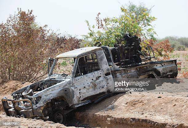A bulletridden pickup truck belonging to Islamic extremists lies in a ditch off the road outside the central Malian town of Kona March 8 2013 AFP...