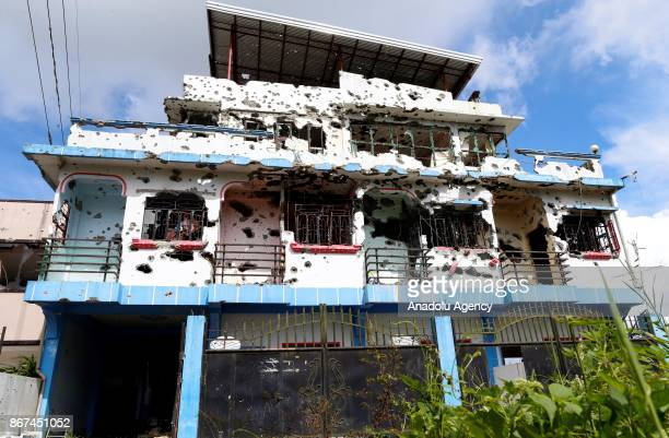 A bulletriddled apartment believed to have been rented by Abu Sayyaf leader Isnilon Hapilon is seen at a residential area in Marawi Philippines on...