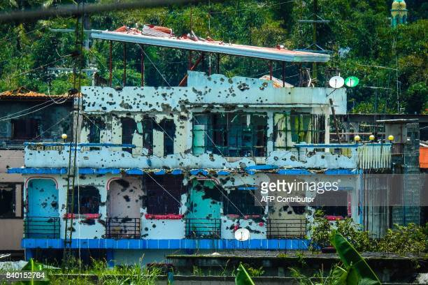 Bulletriddled houses are seen in Marawi on the southern island of Mindanao on August 28 2017 Soldiers killed 10 suspected militants on August 28 as...