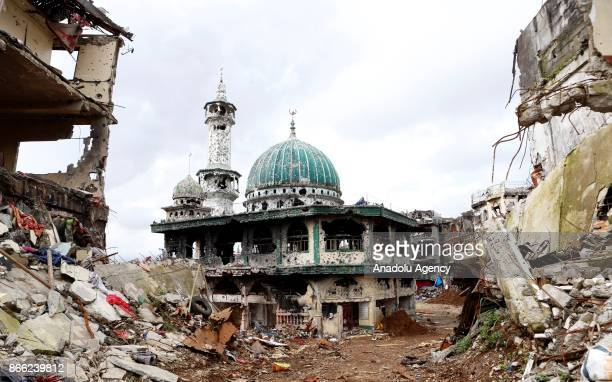A bulletriddled mosque used by Daesh terrorists heavily damaged in the five month long main battle is seen in Marawi Lanao del Sur in the Southern...