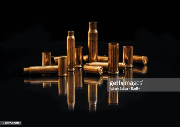 bullets against black background - bullet stock pictures, royalty-free photos & images