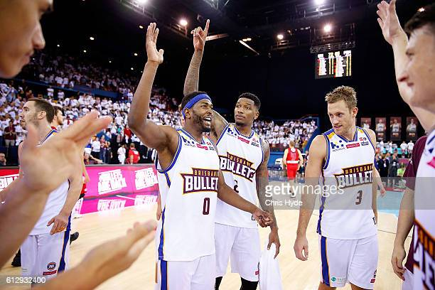 Bullets celebrate winning the round one NBL match between the Brisbane Bullets and the Perth Wildcats at the Brisbane Entertainment Centre on October...