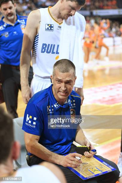 Bullets coach Andrej Lemanis speaks with his team at a time out during the round 14 NBL match between the Cairns Taipans and the Brisbane Bullets at...