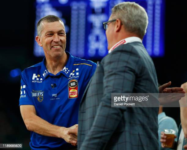 Bullets head coach Andrej Lemanis shakes hands with United head coach Dean Vickerman ahead of the round 8 NBL match between Melbourne United and...