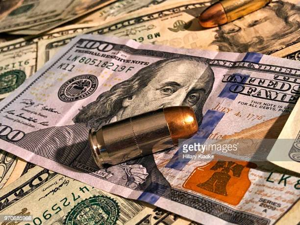 bullets on money - ammunition stock pictures, royalty-free photos & images