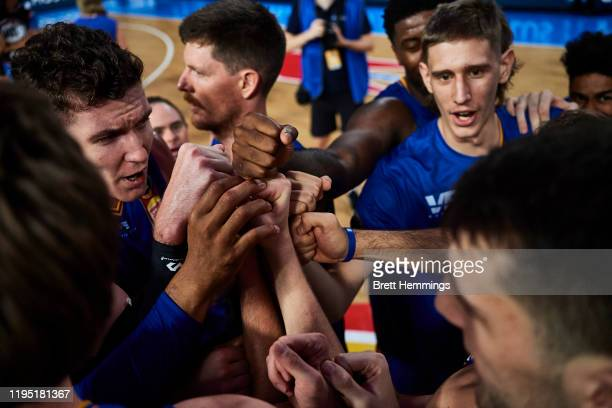 Bullets players celebrate victory during the round 12 NBL match between the Brisbane Bullets and the Sydney Kings at Nissan Arena on December 21,...