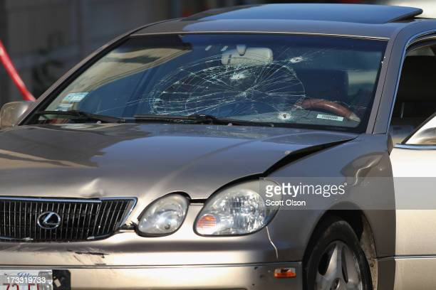 Bullets shattered the windshield of a car driven by a 27yearold man who died after being shot in the chest on July 11 2013 in Chicago Illinois...