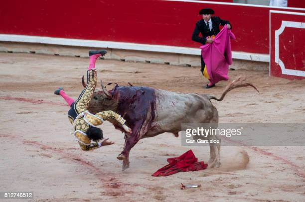 Bullfighter Andres Roca Rey is gored during a bullfighting as part of the sixth day of the San Fermin Running of the Bulls Festival on July 11, 2017...